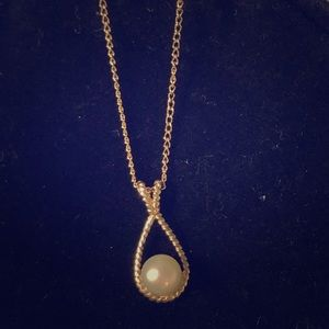 Gold chain with pearl pendant
